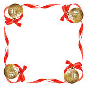 Christmas balls with red bows and ribbons — Stock Photo