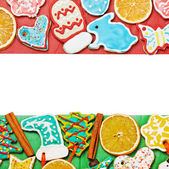 Christmas gingerbread on a red and green — Stock Photo
