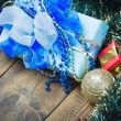 Christmas decorations, balloons and gifts under the tree — Stock Photo