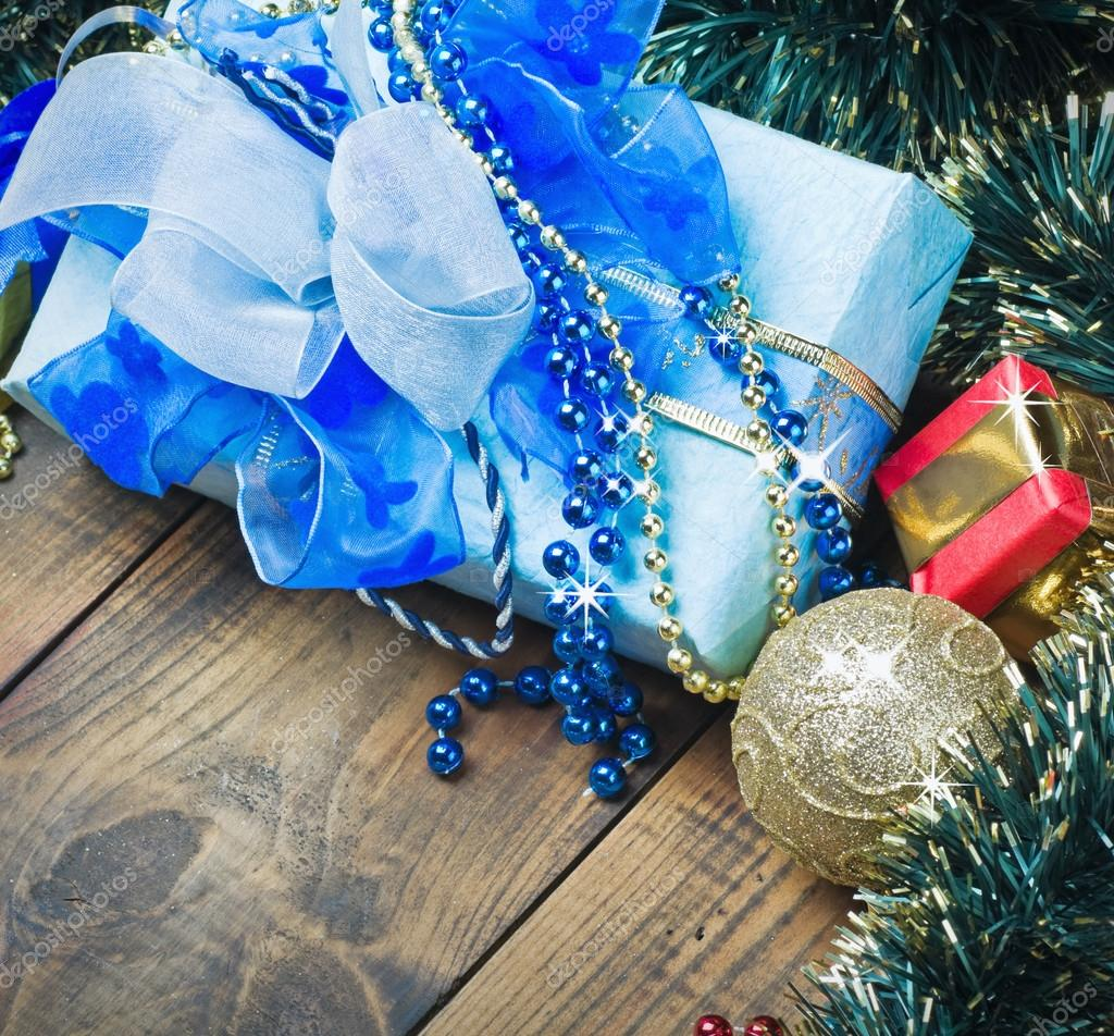 Christmas decorations, balloons and gifts on the table   Stock Photo #15298423