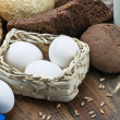 Stock Photo: Fresh eggs and lot of different breads