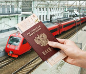 Train ticket in his hand — Stock Photo