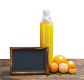 Bottle of juice from citrus fruits — Stock Photo