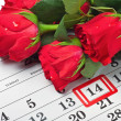 Stock Photo: Roses lay on calendar with date of February 14 Valentine