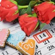 Roses lay on calendar with date of February 14 Valentintext — Stockfoto #17686141