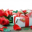 Fresh red roses and gift — Stock Photo
