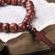 Stock Photo: Wooden rosary and the Bible