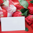 Roses and white card with a place for a congratulatory text — ストック写真