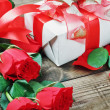 Red roses and holiday gift — Stockfoto #18037569