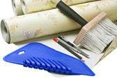 Paper wallpaper and tools for sticking — Stock Photo