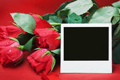 Red roses and blackboard with space for text — Stock Photo