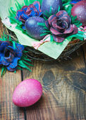 Colorful easter eggs in brown a basket — Stock Photo