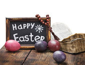 Decorated with painted Easter eggs and an open bible wooden tabl — Stock Photo