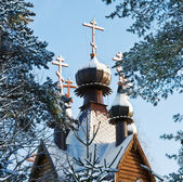 Wooden church and the golden crosses of the winter — Stock Photo