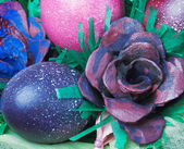 Colorful easter eggs and rose — Stock Photo