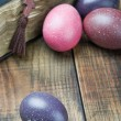 Dyed Easter eggs and religious Christian symbols - Stock Photo