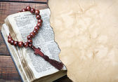 Bible with rosary — Stock Photo