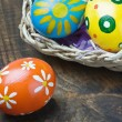 Painted Easter eggs in a basket — Foto de Stock