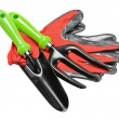 Garden tools and red gloves on white background — Stock Photo