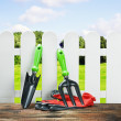 Garden tools and a white fence — Stock Photo #21049149