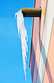 Large icicle hanging from the roof — Stock Photo