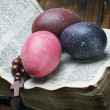 Decorated with painted Easter eggs and an open bible  — Stock Photo