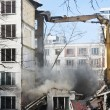 Stock Photo: Demolition of dilapidated and old apartment building