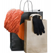 Stock Photo: Shopping bags with clothing isolated on white