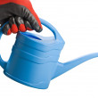 Blue watering can in hand isolated on white background — Stock Photo