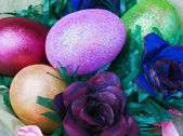 Easter eggs and rose from the egg packaging — Stock Photo