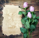 Flowers on vintage wood — Stock Photo