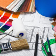 Tools to repair the premises and drawing plans - Stock Photo