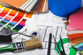 Tools to repair the premises and drawing plans — Stock Photo