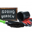 Garden tools and a blackboard with the words in the spring garde - Stock Photo
