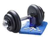 Dumbbell and pills isolated on white background — Stock Photo