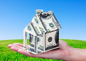 House made of money in hand — Foto Stock