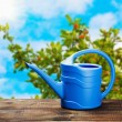Stock Photo: Blue watering con table