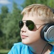 Boy listening to music through headphones — Stock Photo