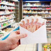 Hand with rubles in the envelope — Stock Photo