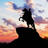 Monument of Peter Great, silhouette against the sunset. St. Pete — Stock Photo