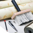 Stock Photo: Paper wallpaper and tools
