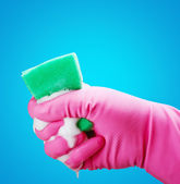 Hand gloves and a sponge — Stock Photo