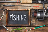 Blackboard with the word fishing — Stock Photo