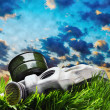 Gas mask lying on the grass against the smoky sky - Stock Photo