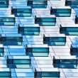 Modern mirrored building facade - Stock Photo