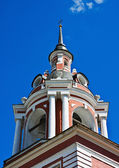 Steeple bell tower with a cross — Stok fotoğraf