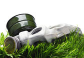 Old gas mask on the Grass — Stock Photo