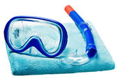 Mask and snorkel for swimming on a towel — Stock Photo