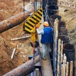 Construction worker directs a lifting mechanism — Stock Photo #25622279