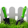 Garden tools near the fence — Stock Photo